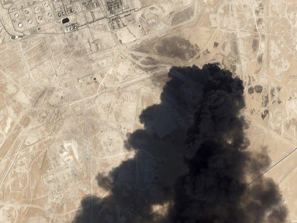 Thick black smoke rises from Saudi Aramco's Abqaiq oil processing facility