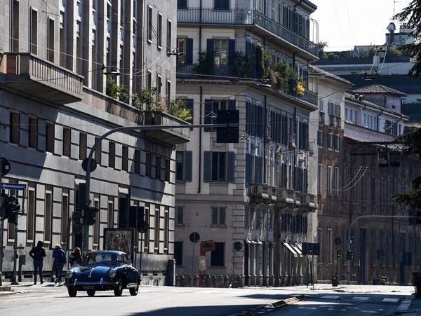 The nearly-deserted Via Senato in central Milan