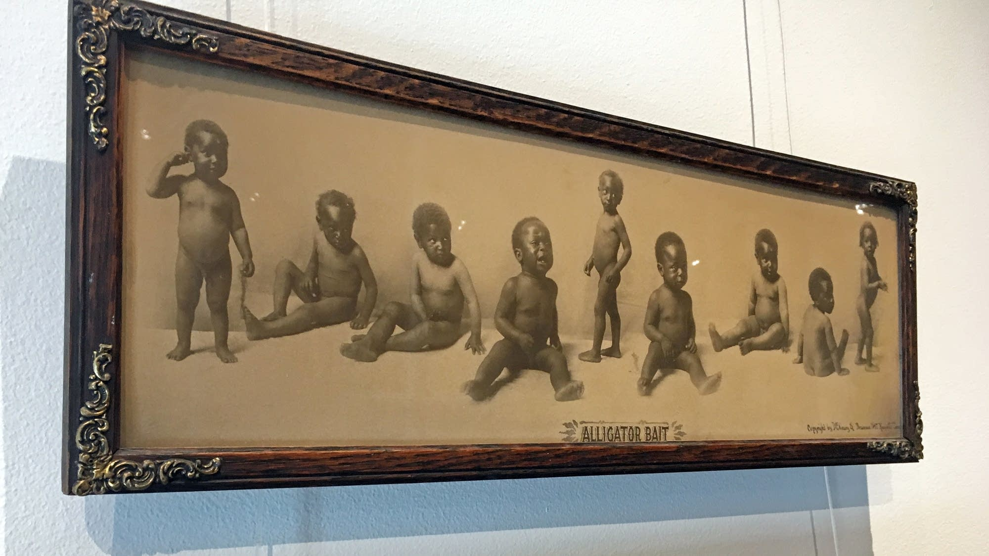 One piece from the Testify exhibit portrays babies as 'alligator bait.'
