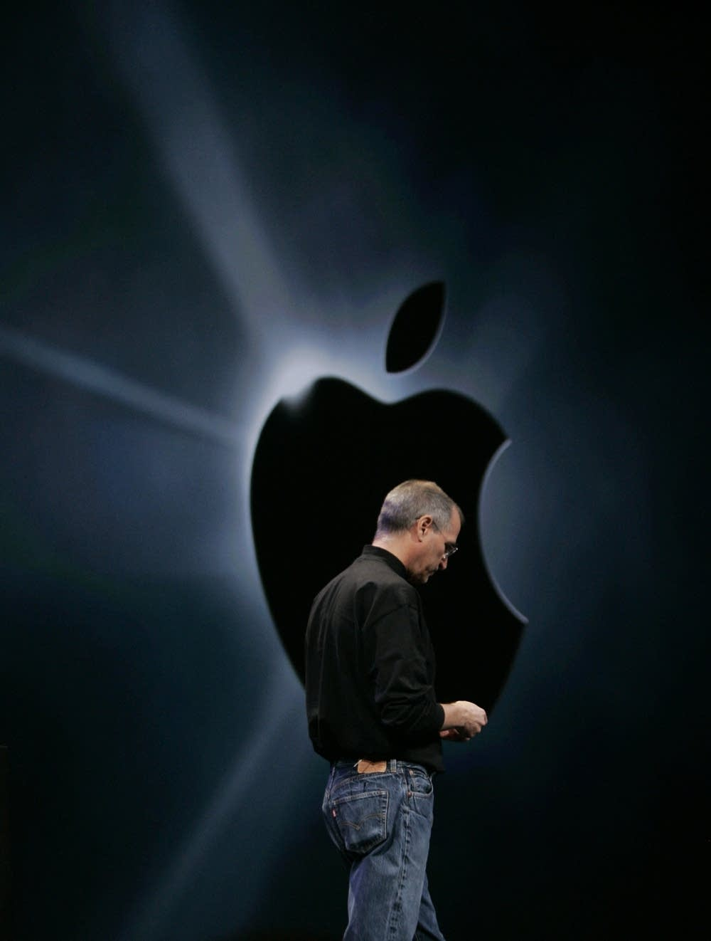 Steve Jobs and the Apple logo