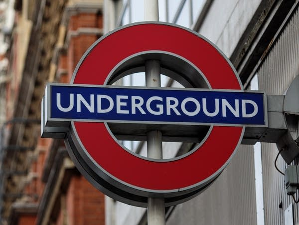 A London Underground sign sits on the side of Sloane Square tube station.