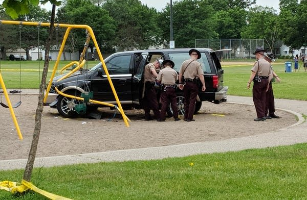 Troopers investigate the scene of a crash at a north Mpls. playground.