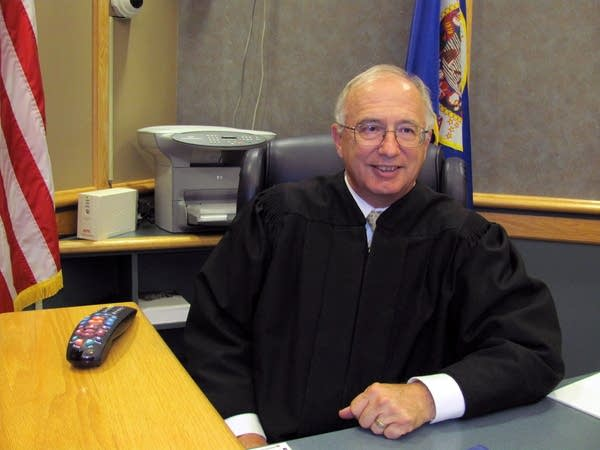 Judge Gerald Seibel sits in his courtroom