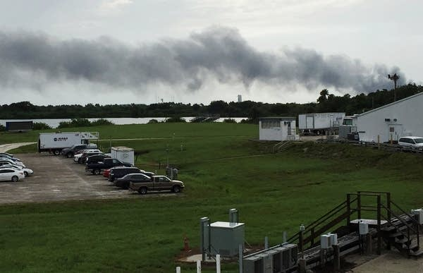 Smoke rises from a SpaceX launch site