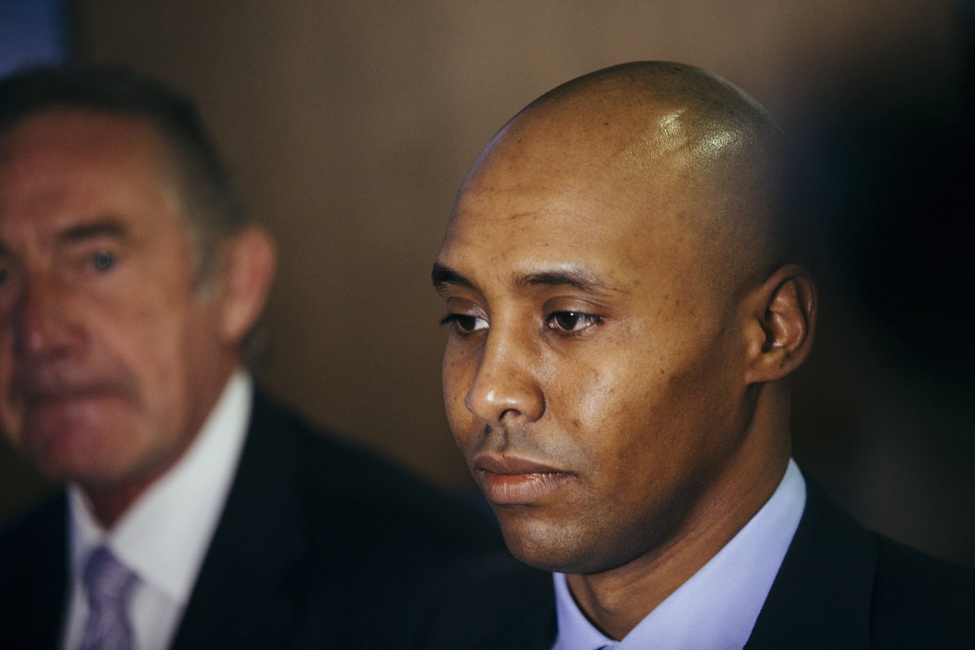 Mohamed Noor is lit by television cameras.