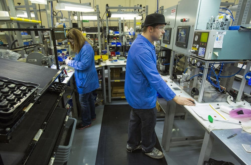 Workers remanufacture variable output devices.