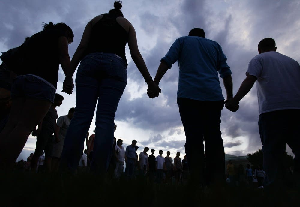 Praying at the memorial service