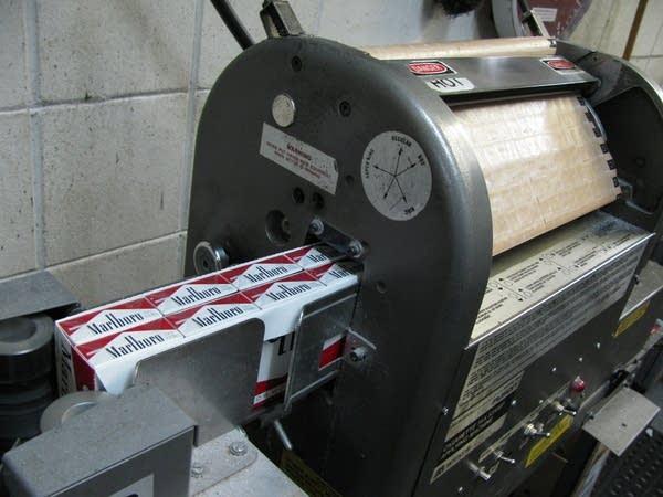 Cigarette stamp machines