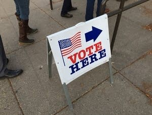 'Vote Here' sign at polling station