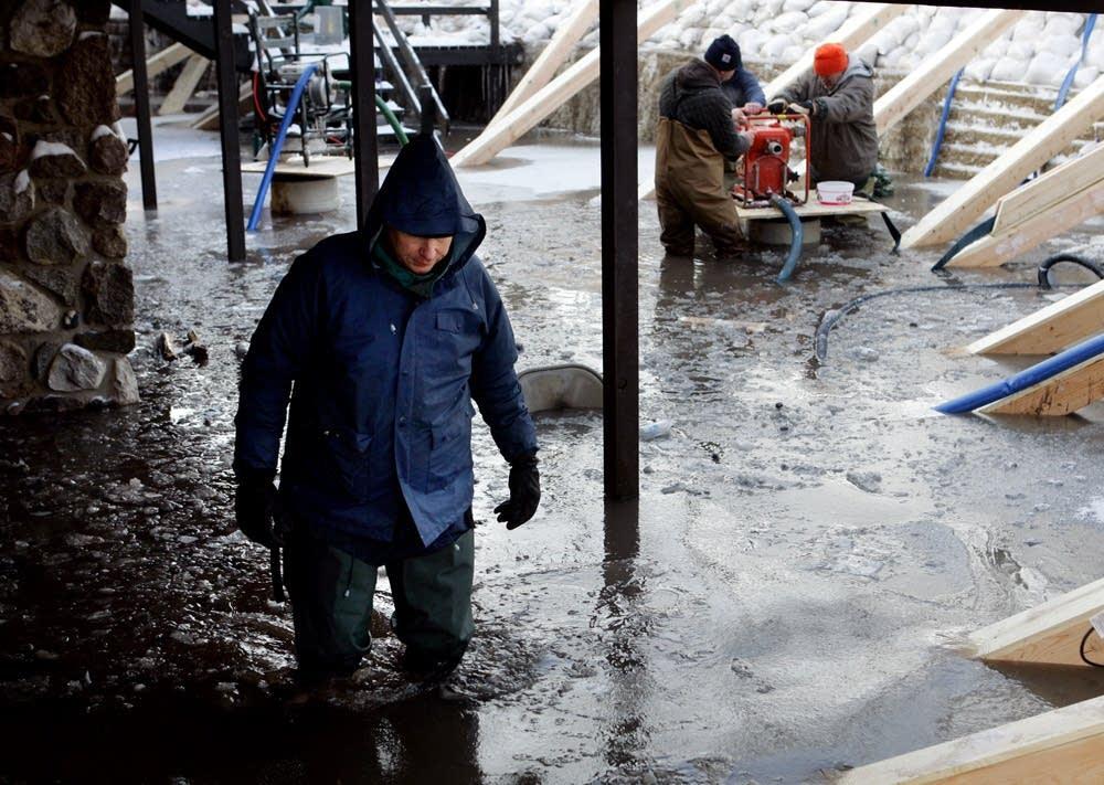 Mark Houglum walks through flood waters
