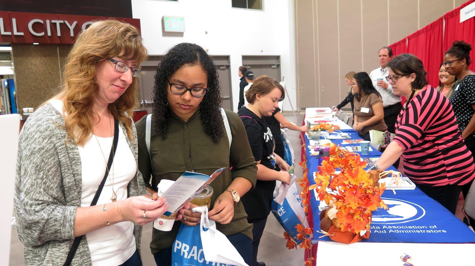 Shelly and Selena Smith examine a brochure.