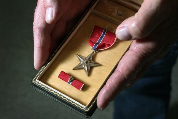 Galen Bungum holds the bronze star he was awarded.