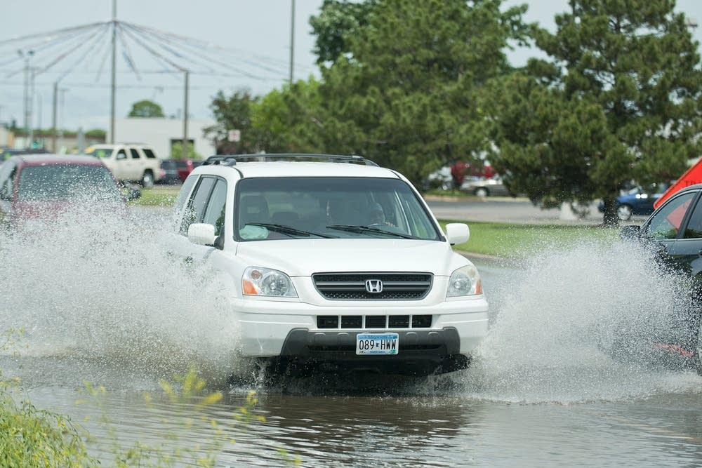 Drivers splash through Bassett Drive in Mankato