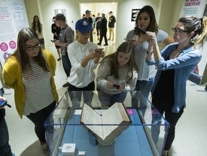 Students around a copy of the First Folio