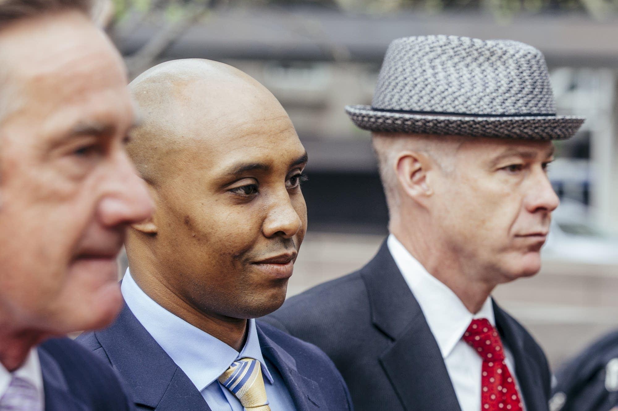 Mohamed Noor walks with his attorneys.