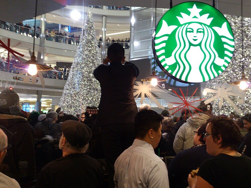 Protesters gather at the Starbucks.