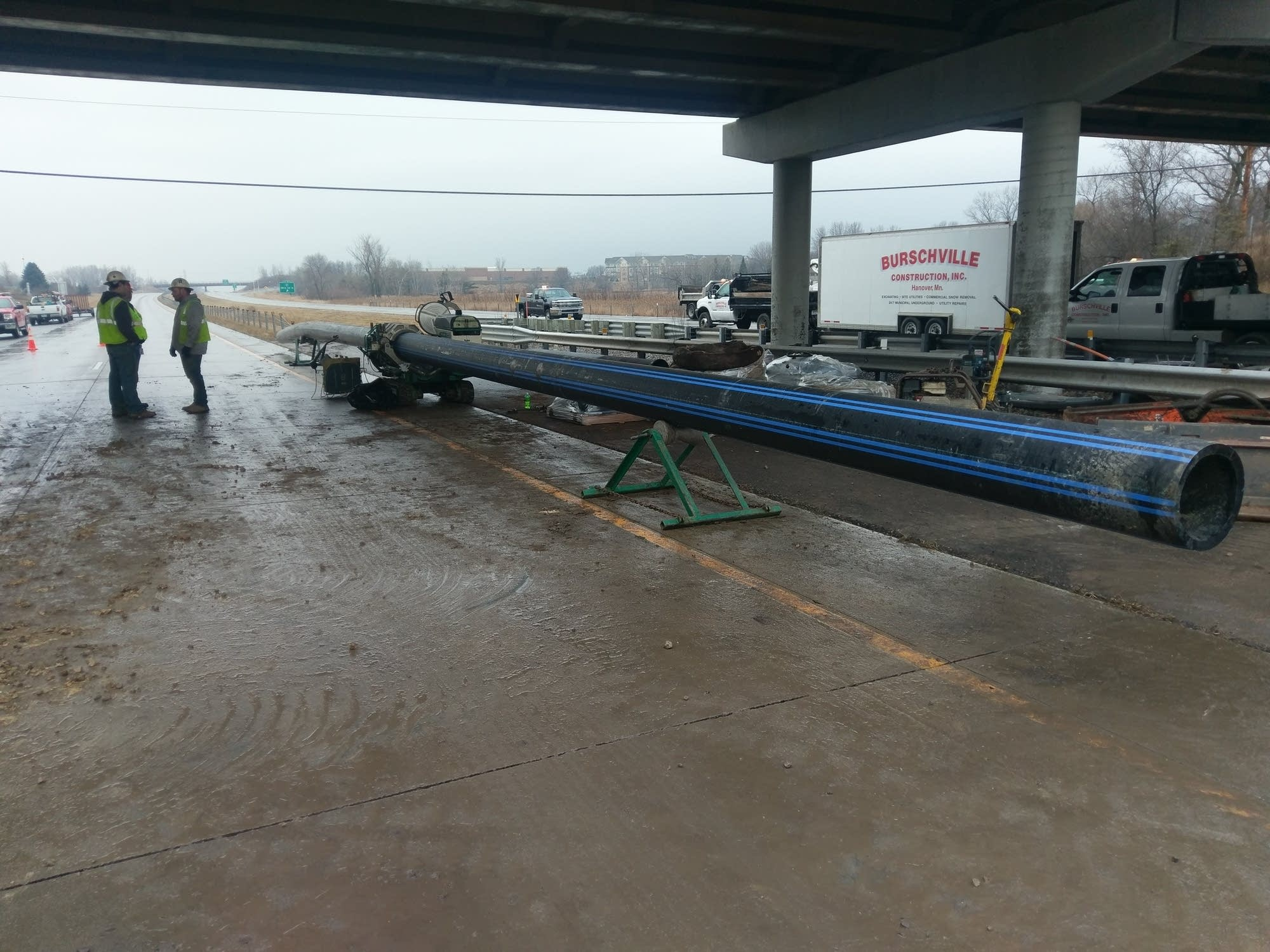 A new water main was being prepared for installation under I-694.
