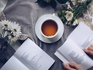 A cup of cold Darjeeling surrounded by some pretty basic poetry