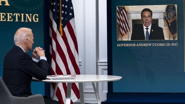 Biden listens as N.Y. Gov. Cuomo speaks during a virtual meeting.