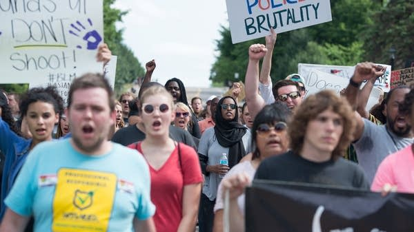 Protesters march from St. Anthony Village.