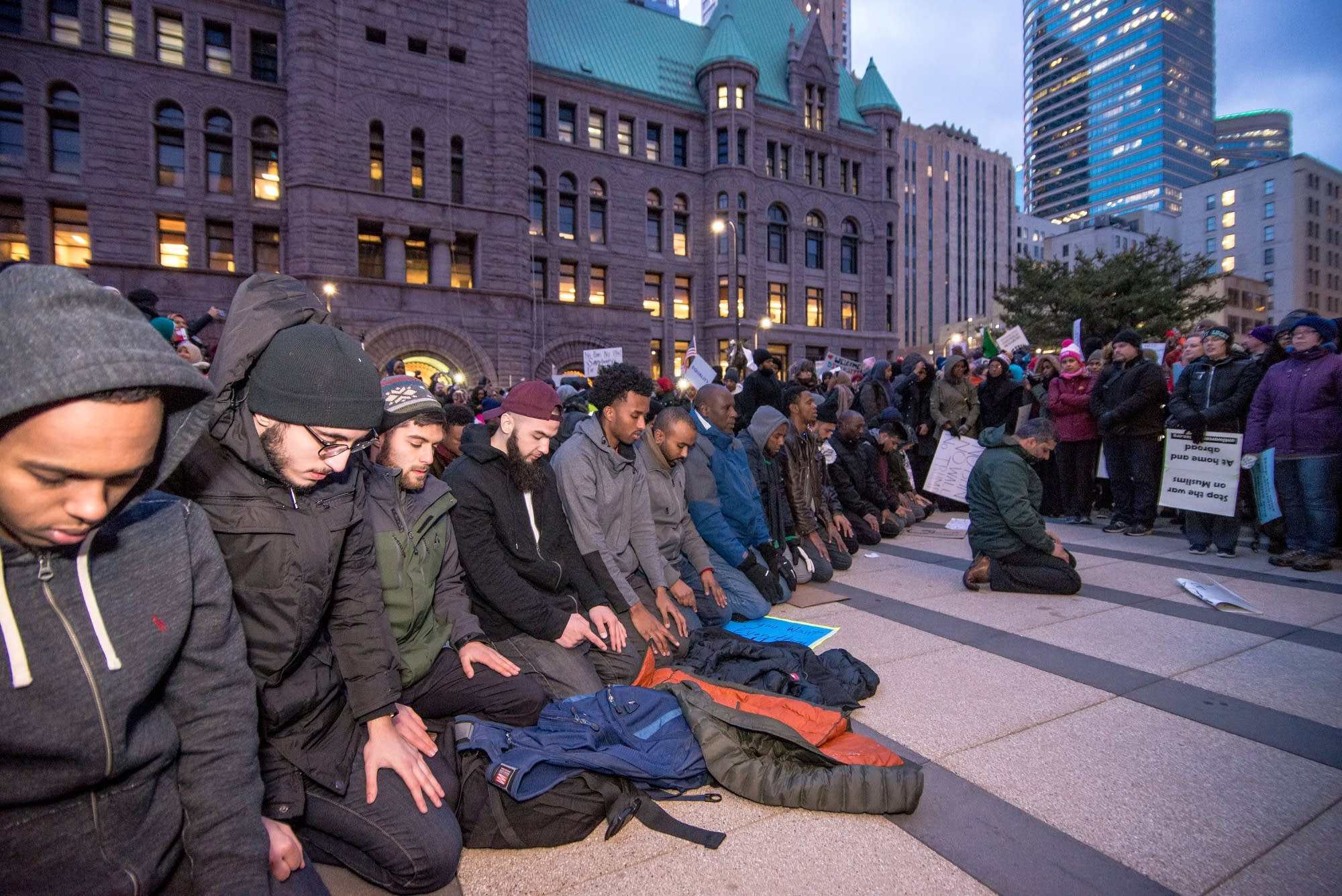Muslim men pray during a protest