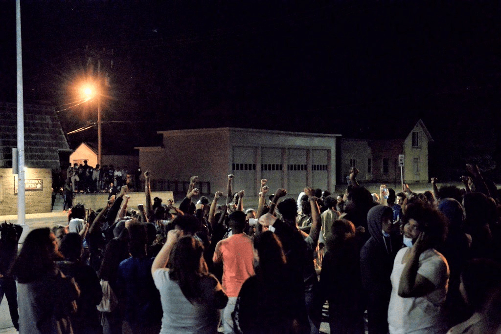 A handful of individuals raised their fists in the air