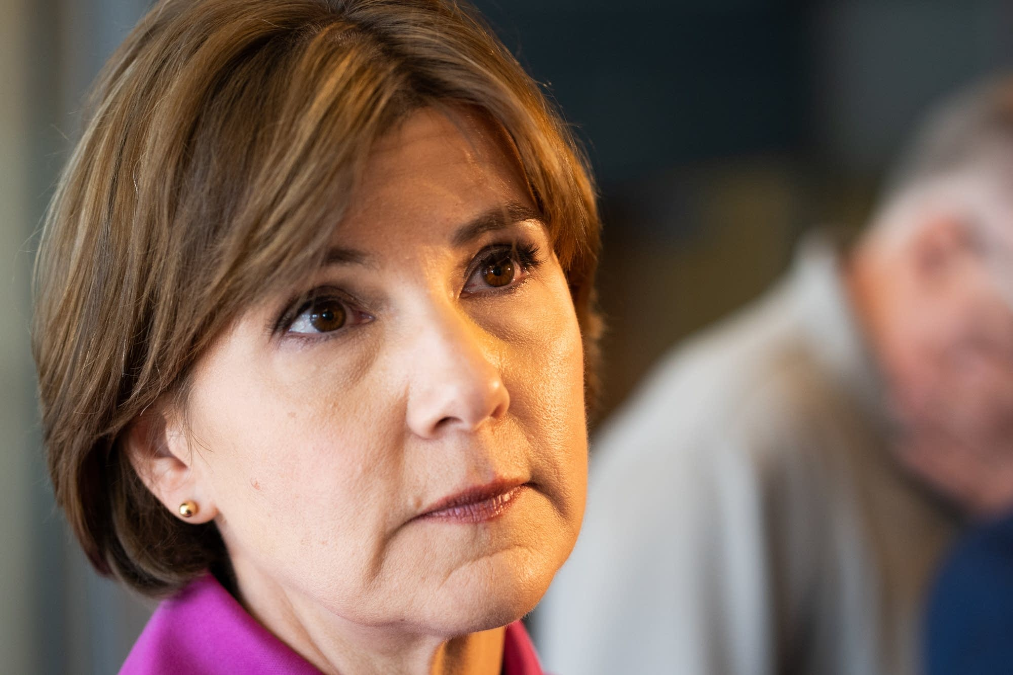 State Attorney General Lori Swanson listens to a question.