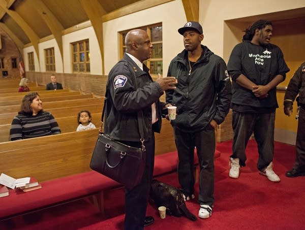 Deputy police chief Art Knight speaks with  activist John Thompson.