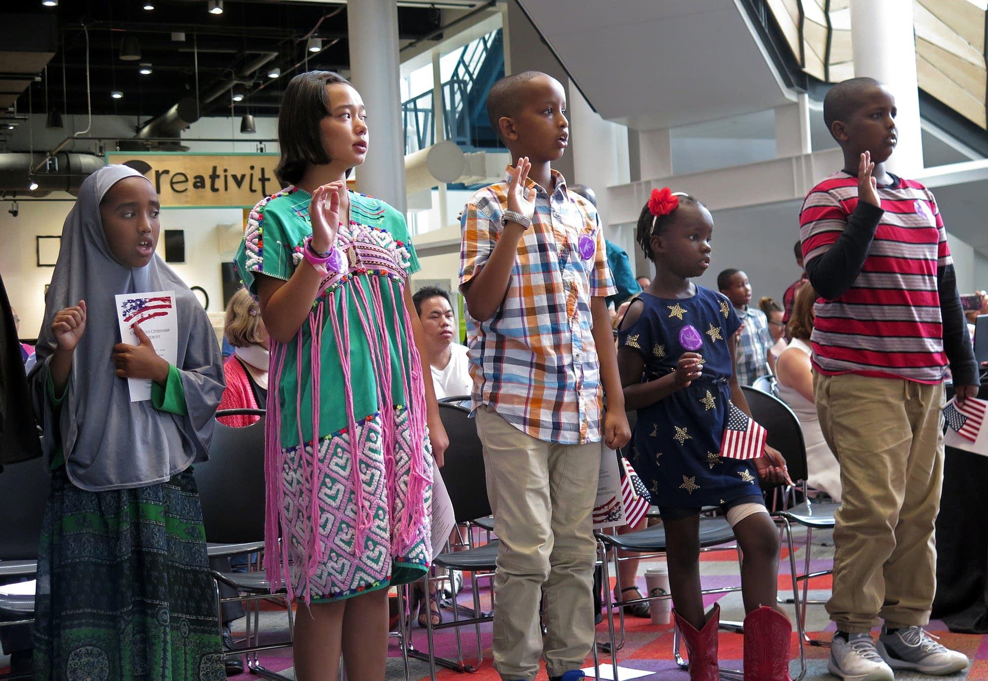 23 children received their citizenship certificates.