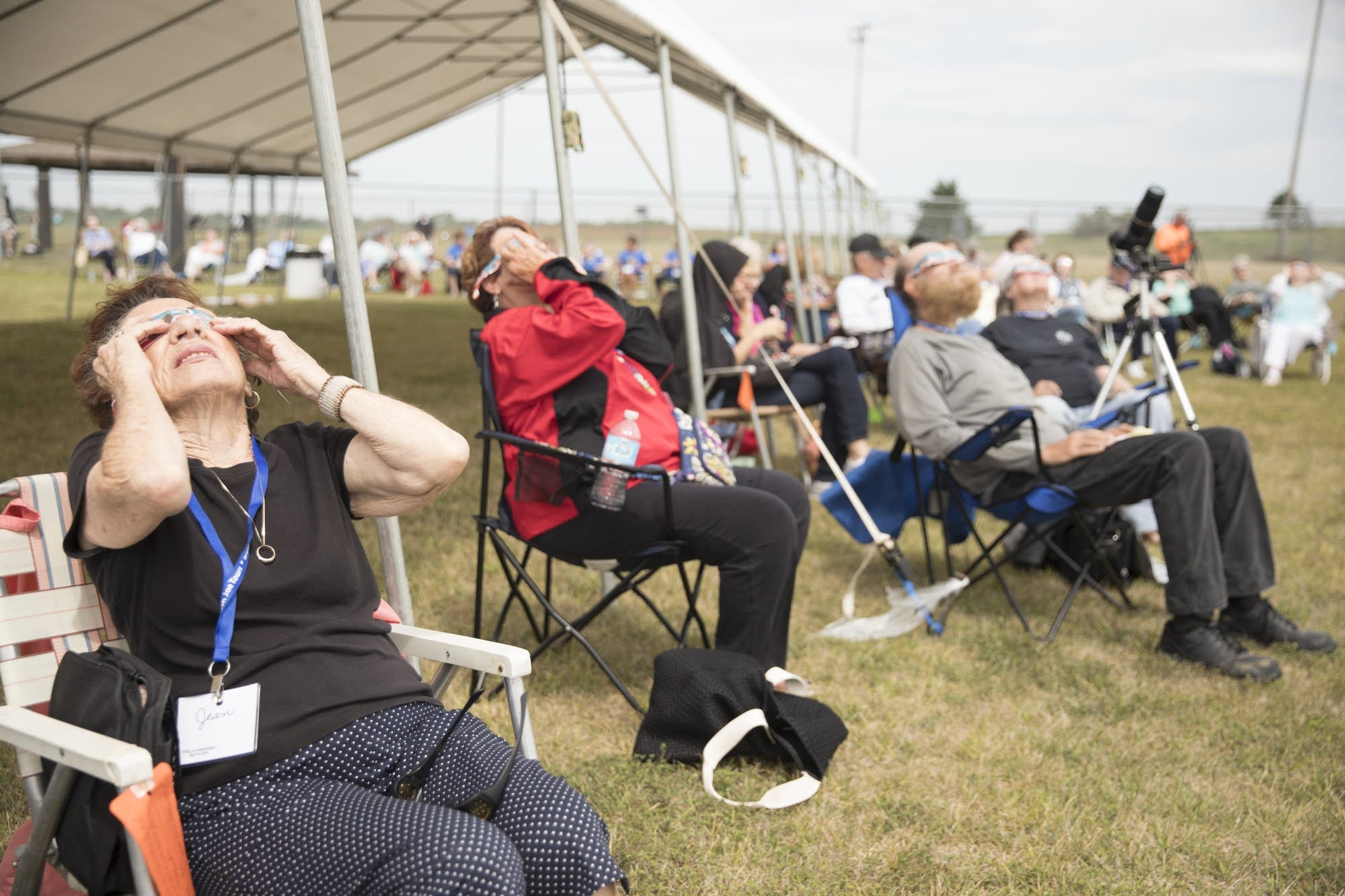 People that came to watch the eclipse stare into the sky.