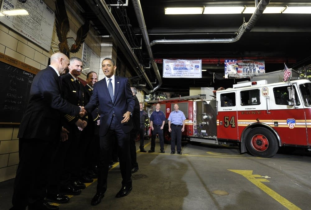 US President Barack Obama greets firefighters