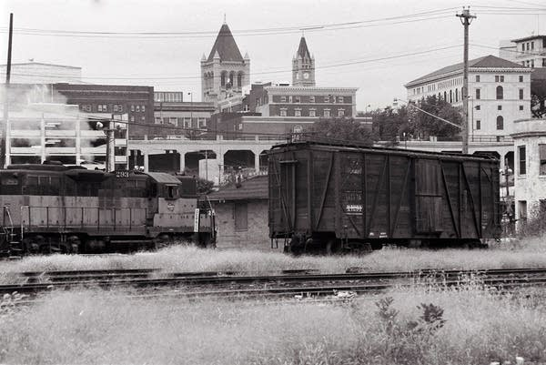 A wooden box car stands on a siding on St. Paul's riverfront in 1978.