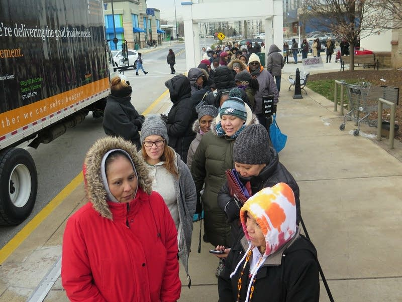 Federal workers wait for food distribution to begin