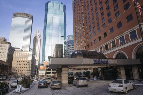 Cars idle outside of the Minneapolis Hilton