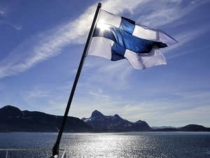 Finland's flag flies aboard the Finnish icebreaker MSV Nordica.