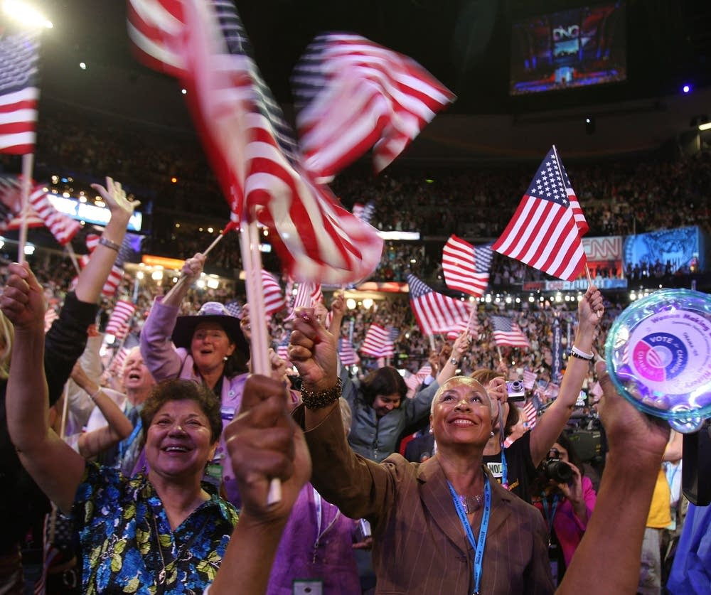 Delegates cheer during day three of the DNC