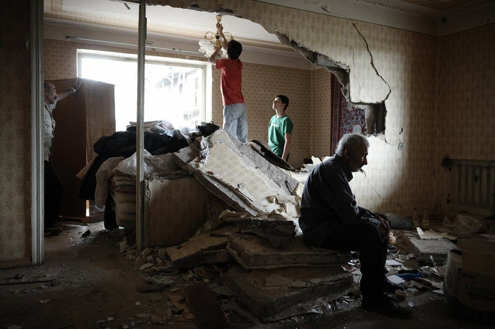 Georgians in a house destroyed by a Russian bomb.