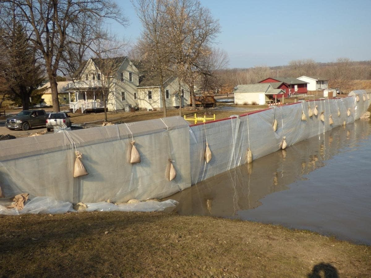 About 35 volunteers helped build a dike to prevent flooding in Henderson