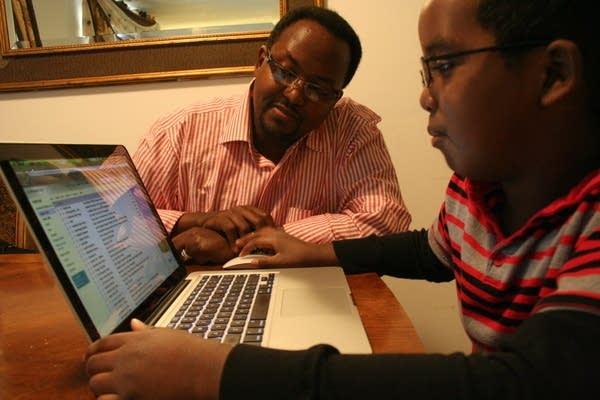Mohamed Aden and son