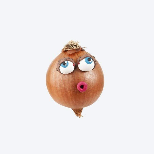 Getty Image of an onion dressed as a woman