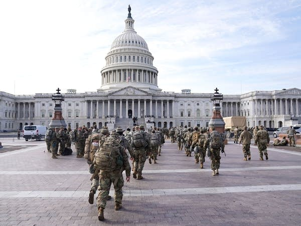 National Guard troops assemble outside of the U.S. Capitol