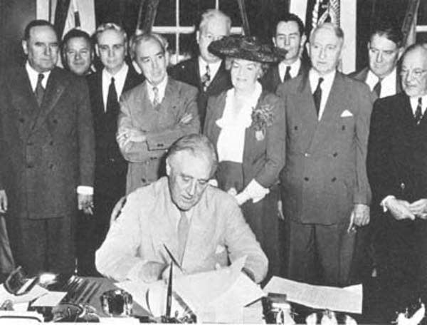 Franklin D. Roosevelt signing the GI Bill