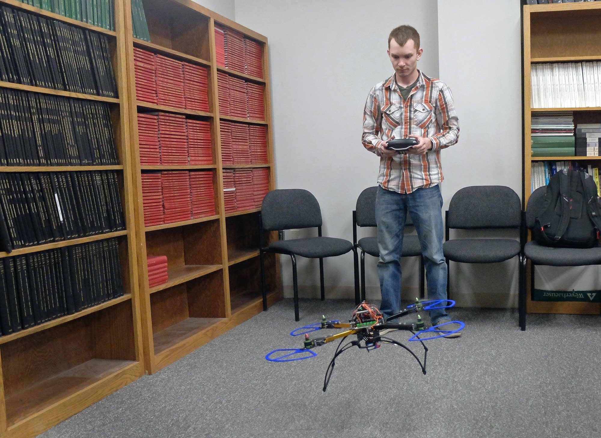 Engineering student Brady Goenner tests a small drone he helped design.