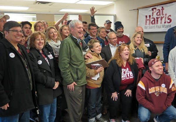 St. Paul mayoral candidate Pat Harris poses for a photo with volunteers.