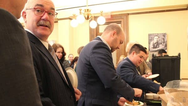 State lawmakers and staff line up for sambusas.
