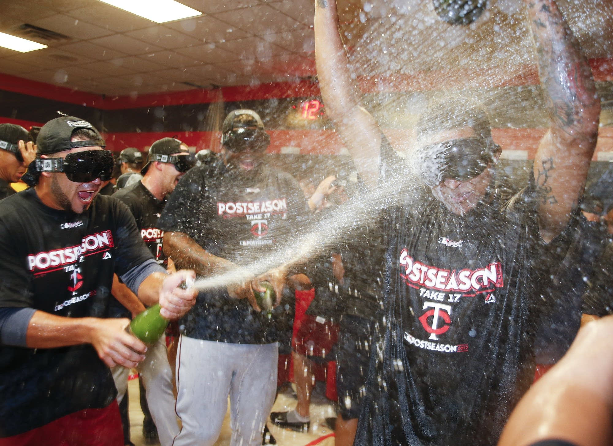 The Minnesota Twins celebrate after earning an AL wild-card berth.