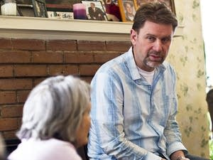 Dwayne Voegeli speaks with other members of the Winona Interfaith Council.