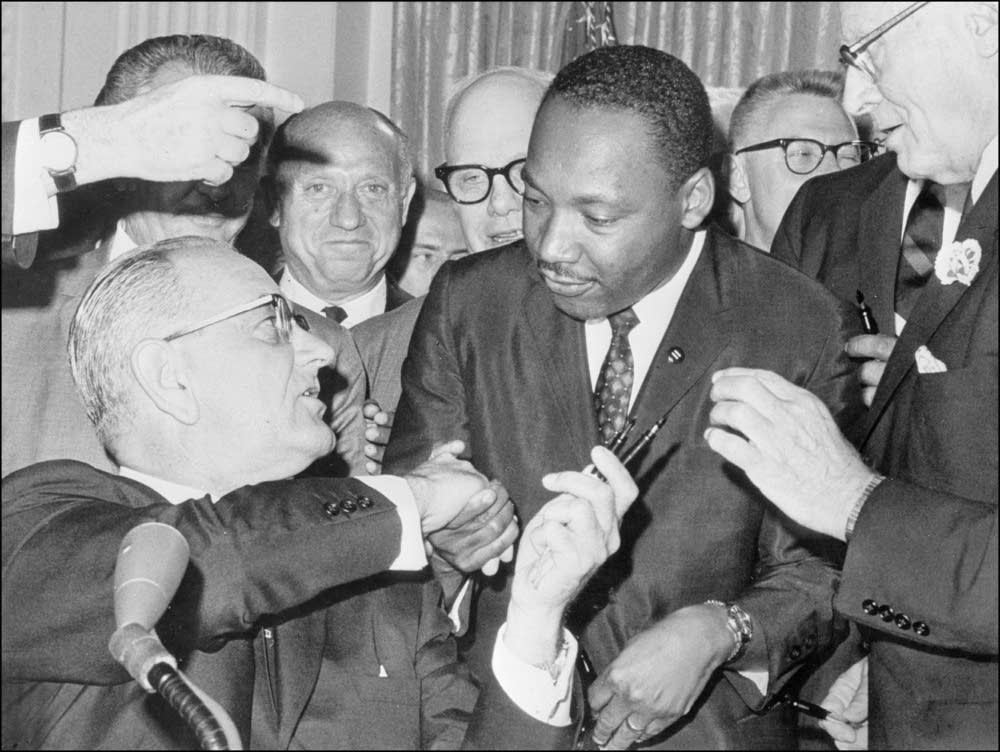 LBJ and MLK shake hands on civil rights bill