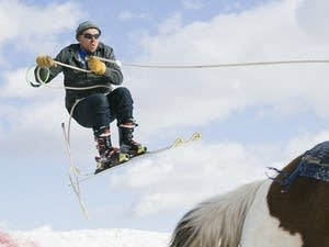 Ryan Wolosyn catches air off a jump at the Extreme Horse Skijoring event.