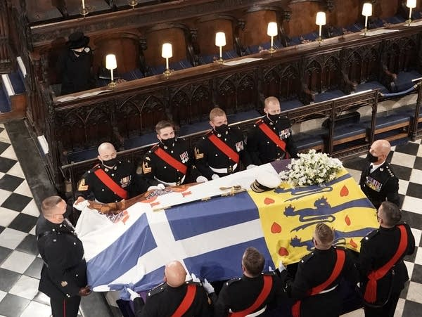 Britain's Queen Elizabeth II looks on the flag-draped coffin of her husband